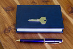 Note Pad, Pen and key. A series of photos with stationery items Royalty Free Stock Image