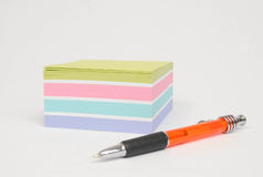 Note pad and pen Stock Images