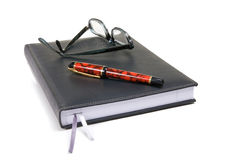 Note Pad with Pen and Specks Stock Image