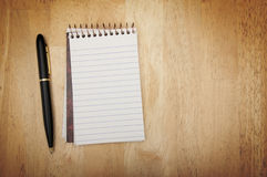 Note Pad and Pen on Wood Stock Photography
