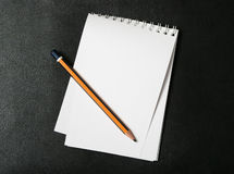 Note pad and pencil Stock Image