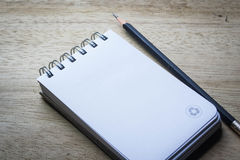 Note pad with pencil Stock Images