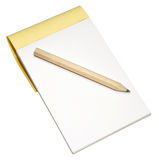 Note Pad And Pencil. A wooden pencil and plain note pad, isolated on a white background Royalty Free Stock Image