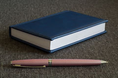 Note Pad and  Pink Pen. A series of photos with stationery items Royalty Free Stock Photos