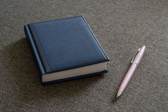 Note Pad and  Pink Pen. A series of photos with stationery items Stock Image