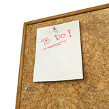 Note pad and push pin isolated on cork board. Ready for your text Stock Images
