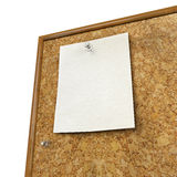 Note pad and push pin isolated on cork board. Ready for your text Stock Photography