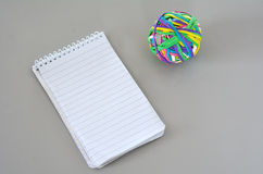 Note Pad with Rubber Band Ball Royalty Free Stock Image
