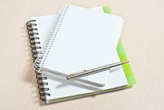 Note pad and silver pen Royalty Free Stock Images