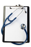 Note pad and stethoscope. On a white background Royalty Free Stock Photography