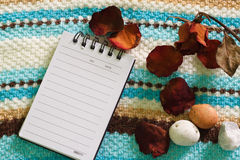 Note pad and white flower. For record Stock Images