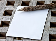 A note pad with wooden pencil Royalty Free Stock Image