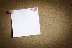 Note paper. On cork board with pin royalty free stock image