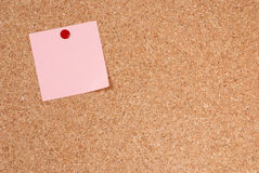 Note-paper. A piece of note-paper tacked to cork royalty free stock photo