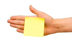 Note paper. Yellow empty note paper glued to the hand Stock Photo