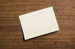 Note paper. On wooden background Royalty Free Stock Photos