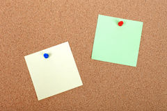 Note paper attched to corkboard. Color note paper attached to corkboard with pushpins. Empty space for your design Stock Photos