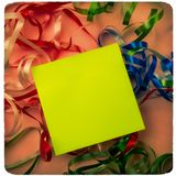 Note paper is on the background of Christmas ribbons stock image
