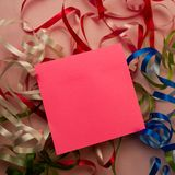 Note paper is on the background of Christmas ribbons royalty free stock photography