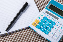 Note paper with calculator and pen Stock Image