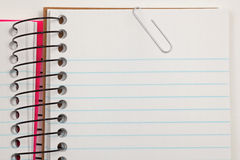 Note paper and clip. Pad of note paper with paper clip. Space for writing a note Stock Images