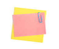 Note paper and clip. Isolated on white background Stock Image