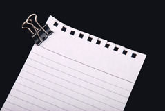 Note paper with clip. Writing note paper with with clip on black background royalty free stock image