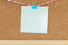 Note paper and clip on cork board Royalty Free Stock Image