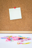 Note paper and clip on cork board Stock Image