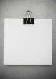 Note paper and clip at metal background Stock Photography