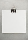 Note paper and clip at metal background Royalty Free Stock Image