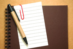 Note paper clip on notebook with pen Stock Image
