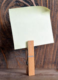 Note paper with a clothespin Stock Images