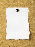 Note paper on a cork board. Closeup stock image
