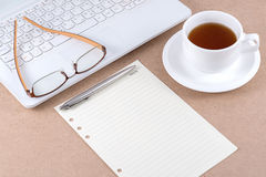 Note paper and eyeglasses on laptop. Note paper and eyeglasses on laptop with a cup of coffee Stock Photo