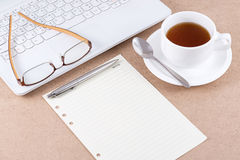 Note paper and eyeglasses on laptop. Note paper and eyeglasses on laptop with a cup of coffee Royalty Free Stock Image