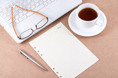 Note paper and eyeglasses on laptop. Note paper and eyeglasses on laptop with a cup of coffee Royalty Free Stock Images