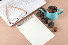 Note paper and eyeglasses on laptop. Stock Image