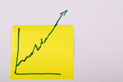 Note paper with finance business graph going up - profit Stock Images