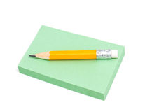 Note paper and grey pencil Stock Photo