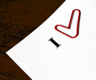 Note paper and heart from paper-clip. Close up Royalty Free Stock Photo
