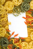 Note paper on Italian pasta background Royalty Free Stock Photo