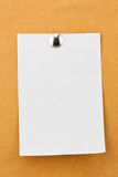 Note paper with metal push pins Stock Photo
