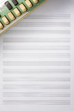 Note paper for musical notes with old accordion. Stock Photos