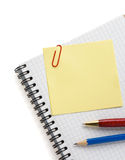 Note paper and notebook on white. Background Royalty Free Stock Photos