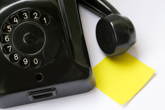 Note paper and old phone. Blank note paper and old phone. You can write your own text on it Royalty Free Stock Photos