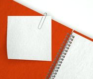 Note paper in open notebook Stock Images