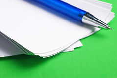 Note paper with pen. Writing note paper with pen on green background stock photography