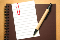 Note paper with pen Stock Image