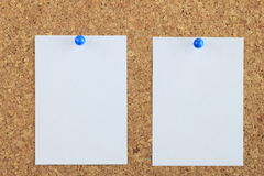 Note paper pined on cork board background Royalty Free Stock Photos